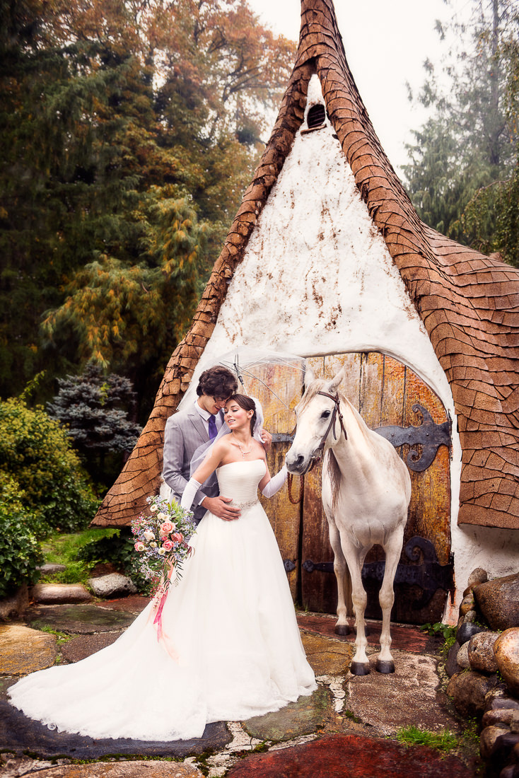 best wedding photographer Pensacola Orlando | creative imagery by Lazzat Photography | dramatic image outside with white horse, bride and groom. Princess inspired, Olalla Snow White and fairytale style