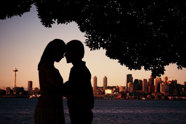 best wedding photographer Pensacola Orlando | creative imagery by Lazzat Photography | beautiful pose silhouette of bride and groom in Seattle with Space Needle in background