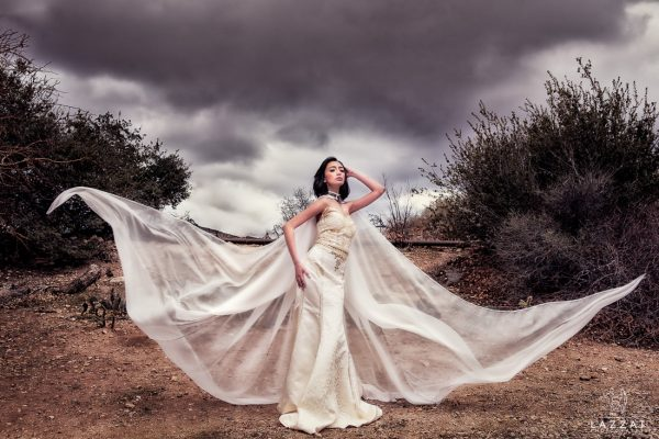 best wedding photographer Pensacola Orlando | creative imagery by Lazzat Photography | dramatic image in Las Vegas desert | bride with flying cape | epic and editorial | high fashion