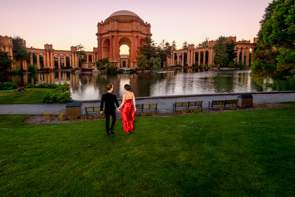 Natalie and Crockett walking away at the Epic Couple's Session at Palace of Fine Arts in San Francisco | Lazzat Photography