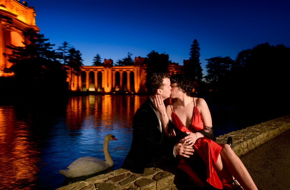 Natalie and Crockett kissing with a swan in the background at the Epic Couple's Session at Palace of Fine Arts in San Francisco | Lazzat Photography