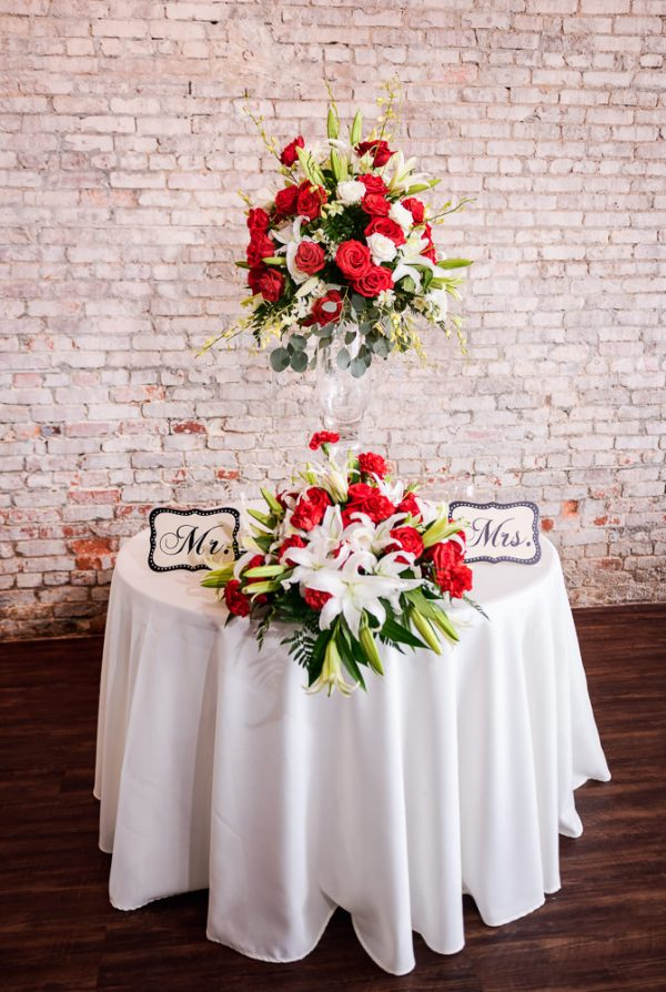 Carla + Lorenzo's sweetheart table at 5Eleven Palafox, Romantic Red Rose Wedding, Lazzat Photography