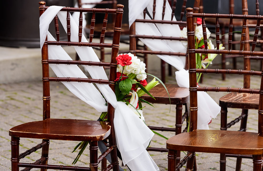Carla + Lorenzo's ceremony chairs outside of 5Eleven Palafox, Romantic Red Rose Wedding, Lazzat Photography