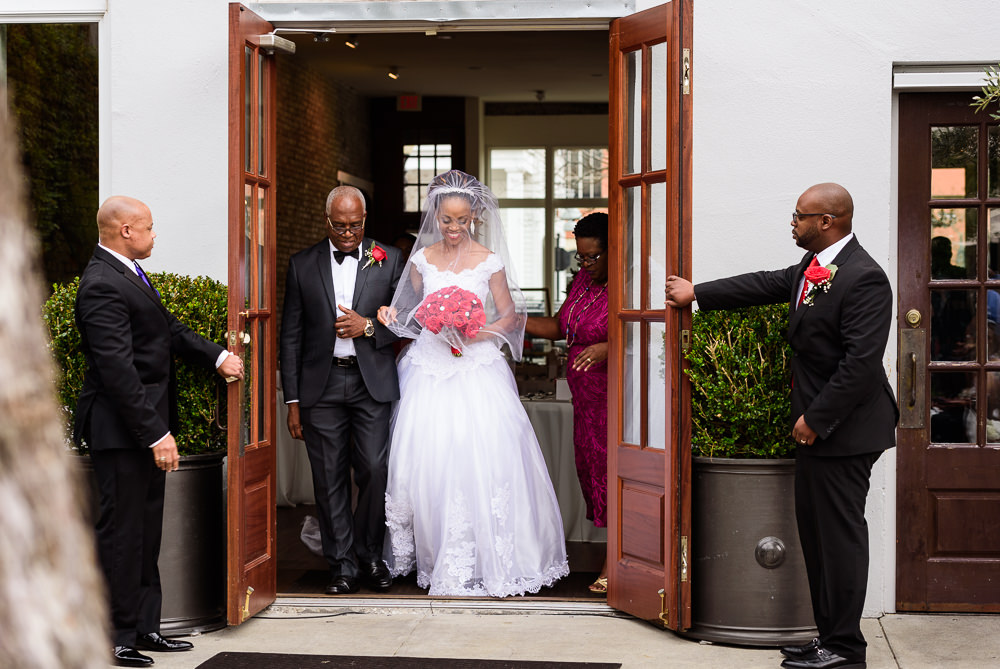 Carla + Lorenzo's exiting 5Eleven Palafox to walk down the aisle, Romantic Red Rose Wedding, Lazzat Photography