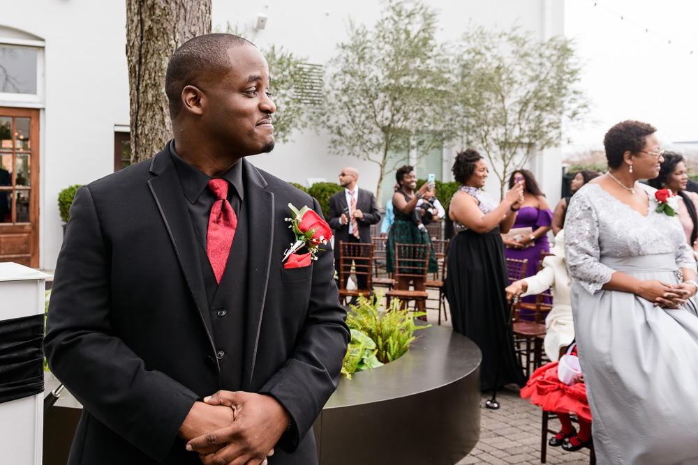 Lorenzo seeing Carla walk down the aisle, 5Eleven Palafox, Romantic Red Rose Wedding, Lazzat Photography