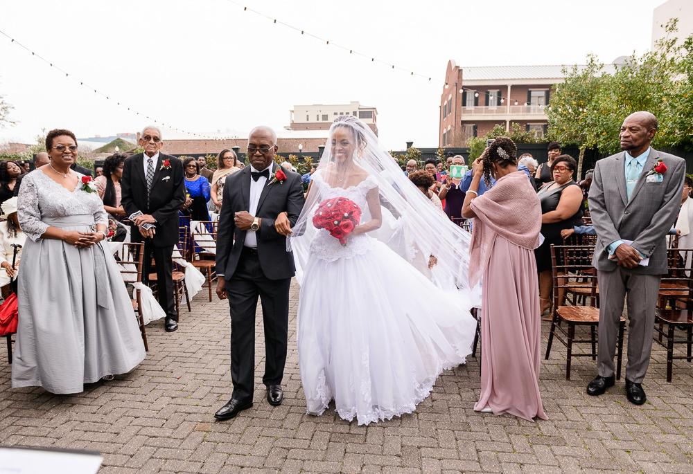 Carla walking down the aisle, 5Eleven Palafox, Romantic Red Rose Wedding, Lazzat Photography