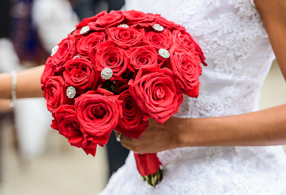 Close up of Carla's red rose bouquet, 5Eleven Palafox, Romantic Red Rose Wedding, Lazzat Photography