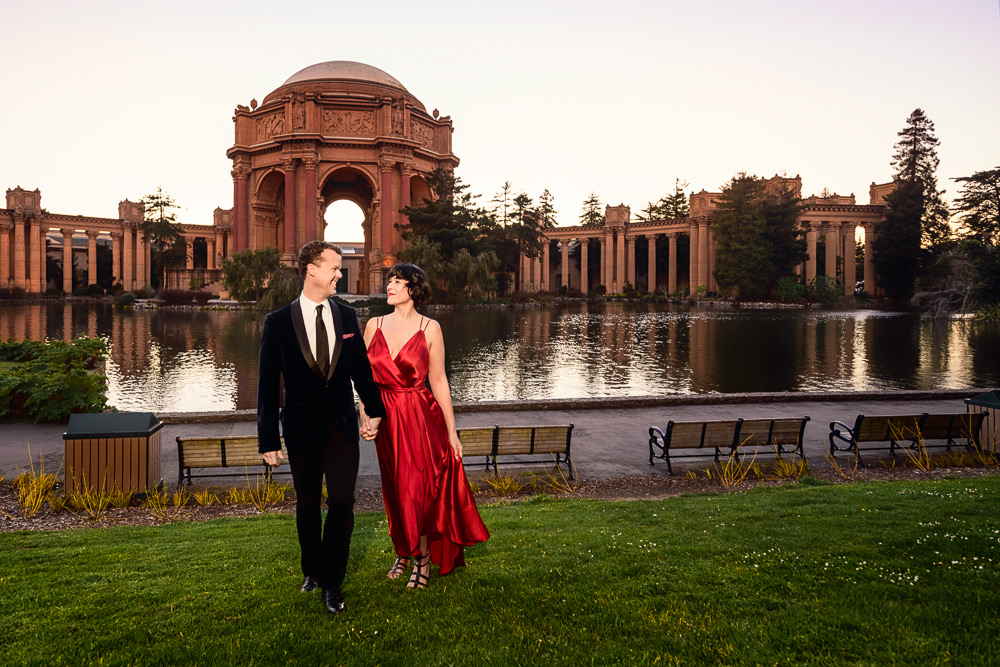 Natalie and Crockett walking towards the camera during the Epic Couple's Session at Palace of Fine Arts in San Francisco | Lazzat Photography