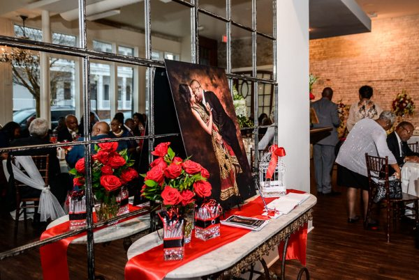 Carla + Lorenzo's engagement photo and guestbook on their entrance table, 5Eleven Palafox, Romantic Red Rose Wedding, Lazzat Photography