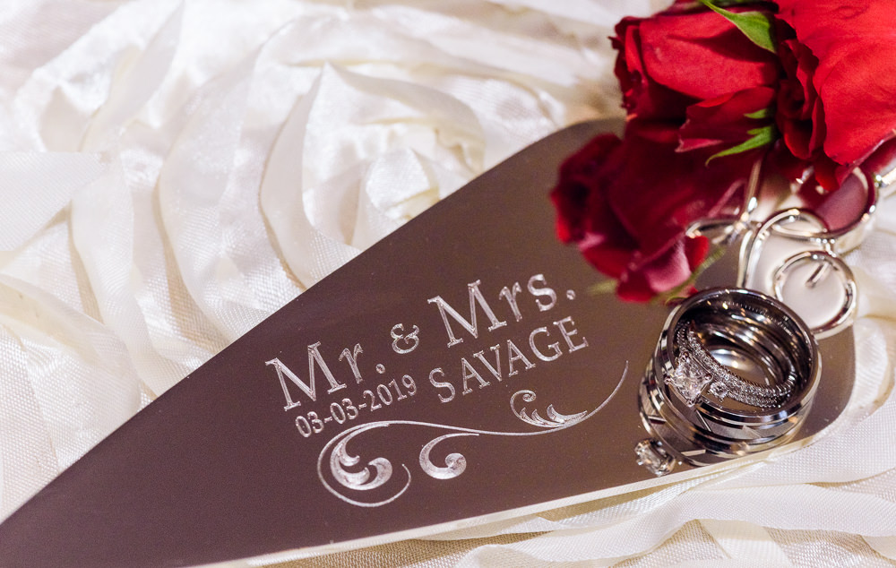 Carla + Lorenzo's rings on their personalized cake server, 5Eleven Palafox, Romantic Red Rose Wedding, Lazzat Photography