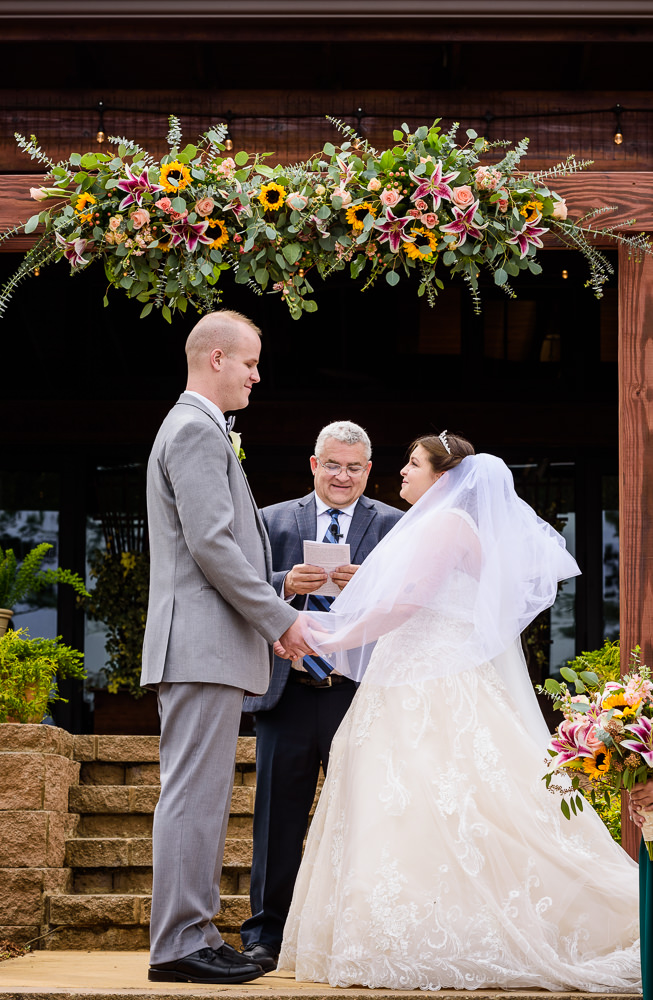 close up of Bride and Groom holding hands at the alter, Coldwater Gardens, Rustic Fairy Tale Wedding, Lazzat Photography