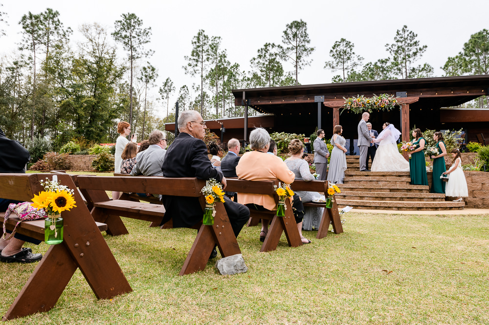 Bride and Groom holding hands at the alter, Coldwater Gardens, Rustic Fairy Tale Wedding, Lazzat Photography