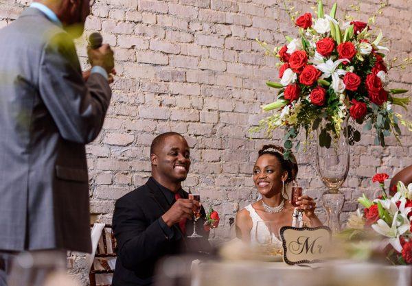 Carla + Lorenzo toasting, 5Eleven Palafox, Romantic Red Rose Wedding, Lazzat Photography