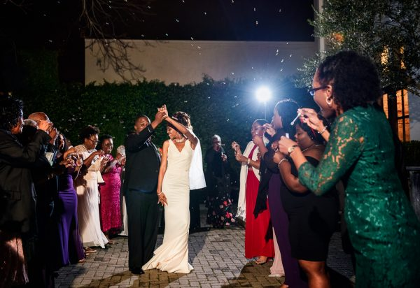 Lorenzo spinning Carla during their bubble exit, 5Eleven Palafox, Romantic Red Rose Wedding, Lazzat Photography