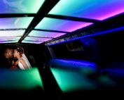 Carla + Lorenza nose to nose inside their limo with dramatic lighting, downtown pensacola, Romantic Red Rose Wedding, Lazzat Photography