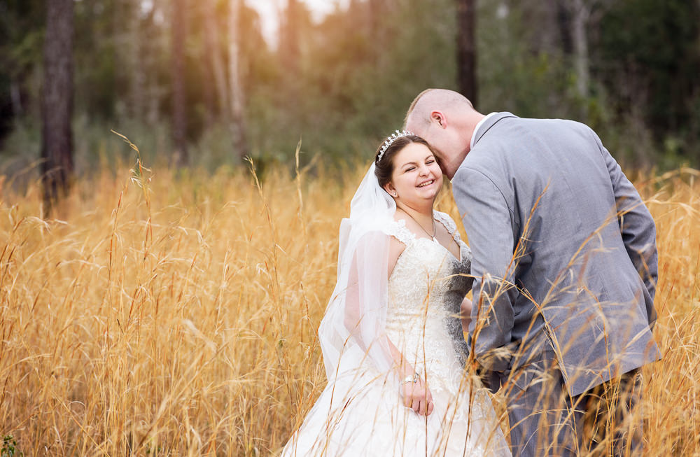 Groom whispering in Bride's ear in the field, Coldwater Gardens, Rustic Fairy Tale Wedding, Lazzat Photography