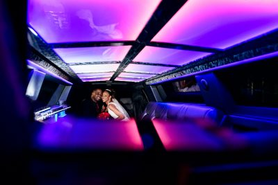 Carla + Lorenza smiling inside their limo, downtown pensacola, Romantic Red Rose Wedding, Lazzat Photography