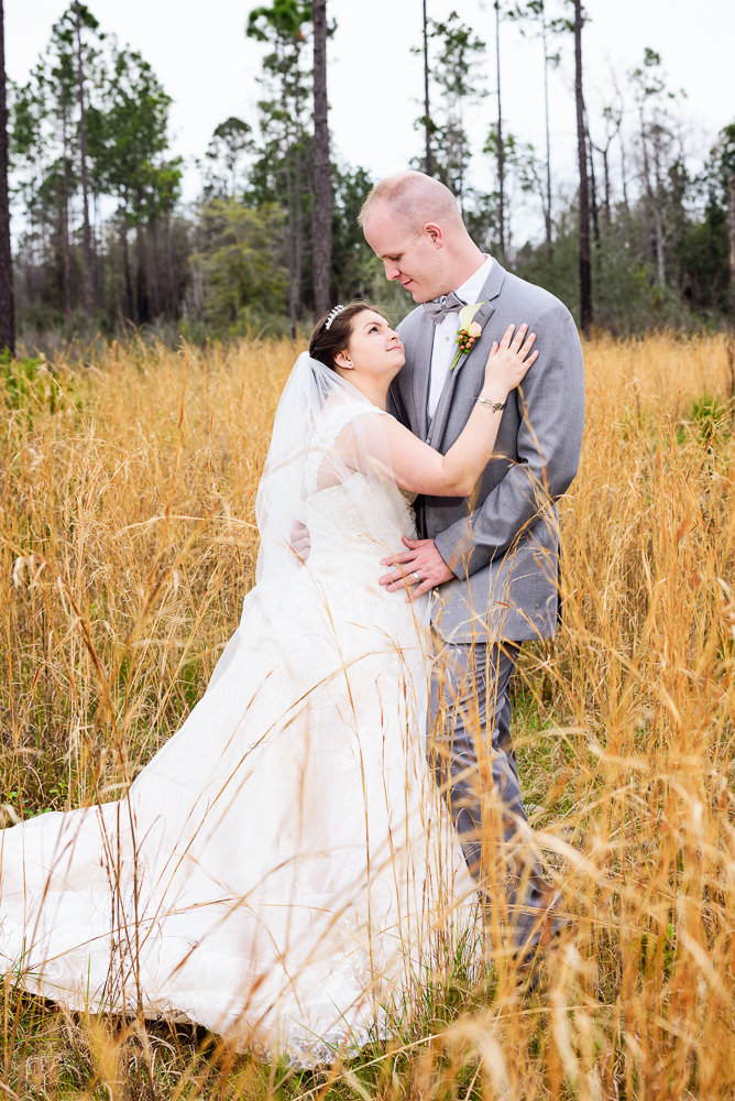 Bride and Groom looking at each other in the field, Coldwater Gardens, Rustic Fairy Tale Wedding, Lazzat Photography