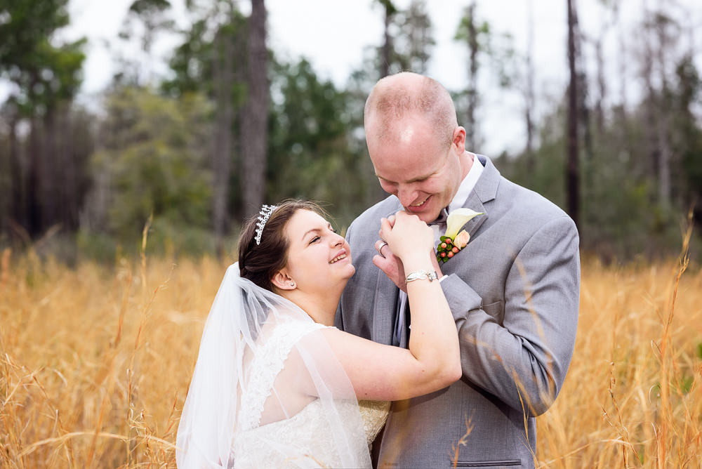 Groom holding Bride's hand in the field, Coldwater Gardens, Rustic Fairy Tale Wedding, Lazzat Photography