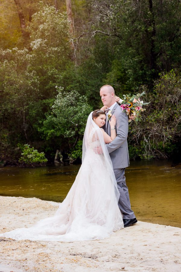 Bride and Groom hugging on the beach, Coldwater Gardens, Rustic Fairy Tale Wedding, Lazzat Photography
