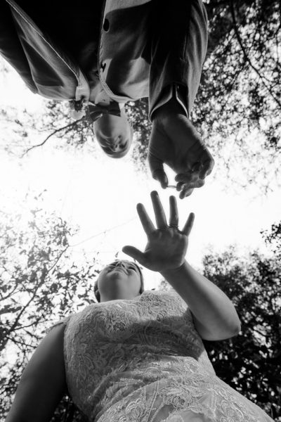 Groom putting Bride's ring on, Photo from below, black and white, Coldwater Gardens, Rustic Fairy Tale Wedding, Lazzat Photography