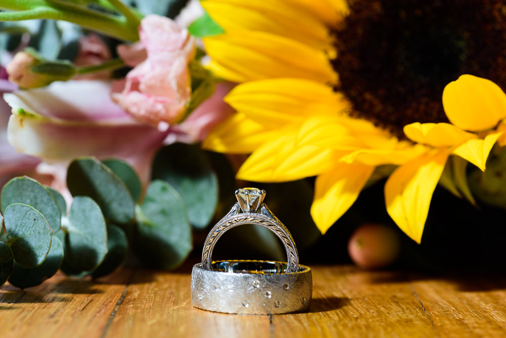 Bride's ring standing inside Groom's ring, Coldwater Gardens, Rustic Fairy Tale Wedding, Lazzat Photography