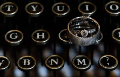 Bride and Groom's wedding rings on the typewriter, Coldwater Gardens, Rustic Fairy Tale Wedding, Lazzat Photography