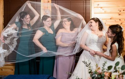 Bride with her mom and bridesmaids under her veil, Coldwater Gardens, Rustic Fairy Tale Wedding, Lazzat Photography