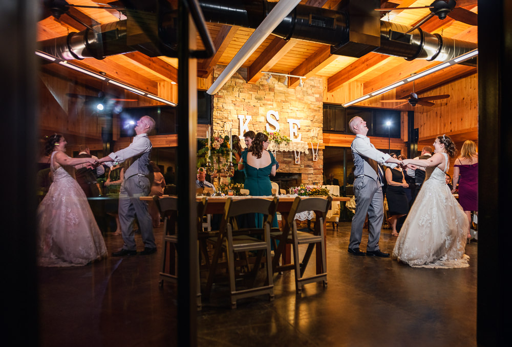 Bride and Groom dancing with the reflection in the door, Coldwater Gardens, Rustic Fairy Tale Wedding, Lazzat Photography