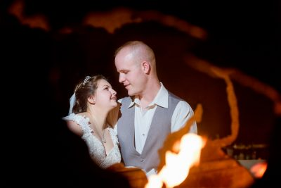 close up of Bride and Groom through the globe shaped fire pit, Coldwater Gardens, Rustic Fairy Tale Wedding, Lazzat Photography