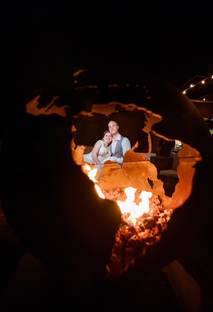Bride and Groom through the globe shaped fire pit, Coldwater Gardens, Rustic Fairy Tale Wedding, Lazzat Photography