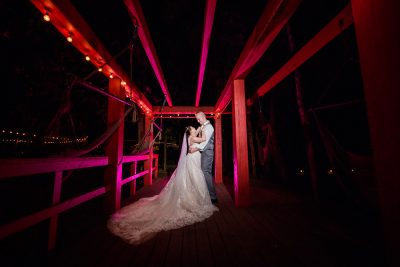 Bride and Groom dancing under red wooden beams, Coldwater Gardens, Rustic Fairy Tale Wedding, Lazzat Photography