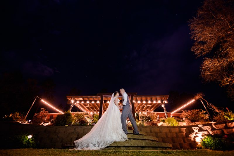 Kyle and Emily in front of their venue at night, Coldwater Gardens, Rustic Fairy Tale Wedding, Lazzat Photography