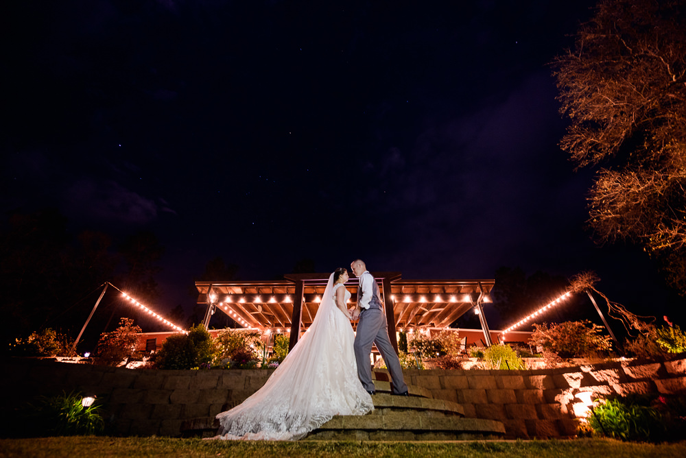 Bride and Groom in front of their venue at night, Coldwater Gardens, Rustic Fairy Tale Wedding, Lazzat Photography
