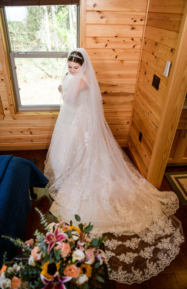 Bride looking down at her veil, Coldwater Gardens, Rustic Fairy Tale Wedding, Lazzat Photography