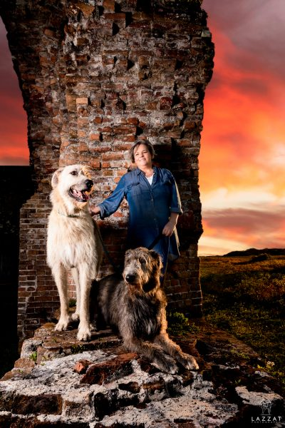 """Two Irish Wolfhounds with """"mom"""" at Fort Pickens at sunset during Epic Dog Photo Session in Florida, Lazzat Photography"""