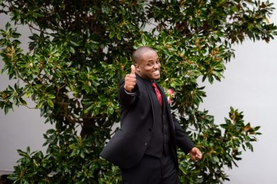 "Lorenzo giving us a ""thumbs up"" outside of 5Eleven Palafox, Romantic Red Rose Wedding, Lazzat Photography"