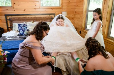 Bride's mom and sister putting her shoes on, Coldwater Gardens, Rustic Fairy Tale Wedding, Lazzat Photography