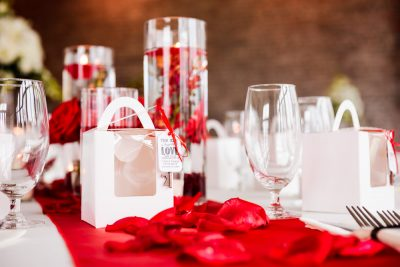 Carla + Lorenzo's table decorations at 5Eleven Palafox, Romantic Red Rose Wedding, Lazzat Photography