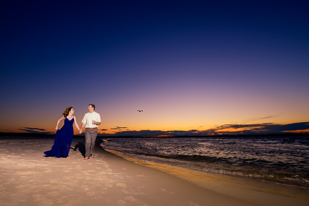 Couple running down the beach at sunset, Fun Engagement Session at Eden Garden and Fort Pickens, Lazzat Photography, engagement photos