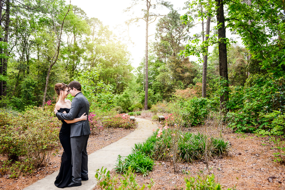 Taylor and Bob standing head to head on the path, Beautiful Mobile Botanical Gardens Engagement Session, Lazzat Photography