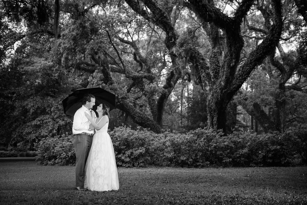 Couple under an umbrella, black and white, Fun Engagement Session at Eden Garden and Fort Pickens, Lazzat Photography, engagement photos