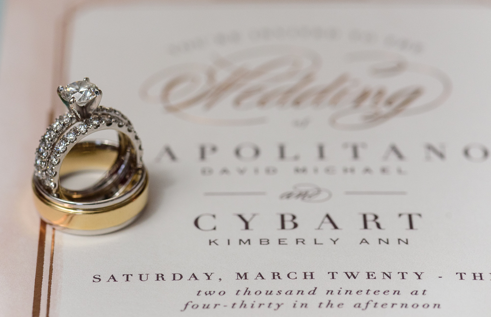 Bride and Groom's wedding rings on top of their invitation at the Rails on Wright Street, Classic Red and White Wedding, Lazzat Photography, wedding photography, wedding photographer