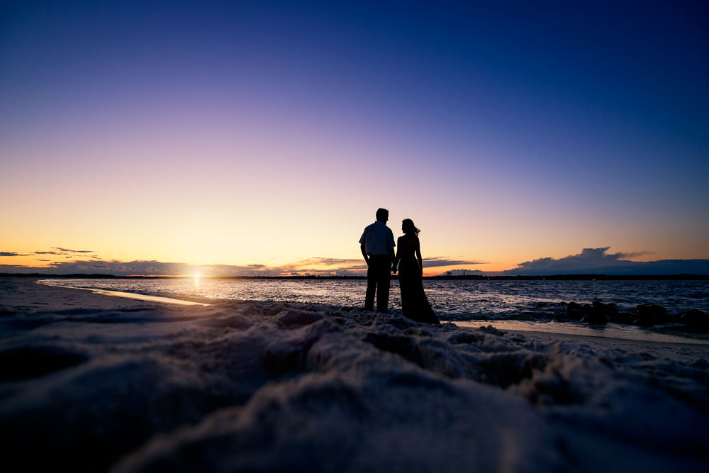 Silhouette of couple on the beach at sunset, Fun Engagement Session at Eden Garden and Fort Pickens, Lazzat Photography, engagement photos