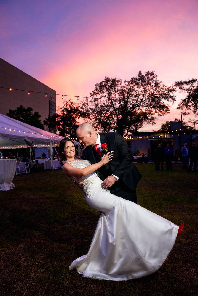 Groom dipping Bride at sunset at the Rails on Wright Street, Classic Red and White Wedding, Lazzat Photography, wedding photography, wedding photographer