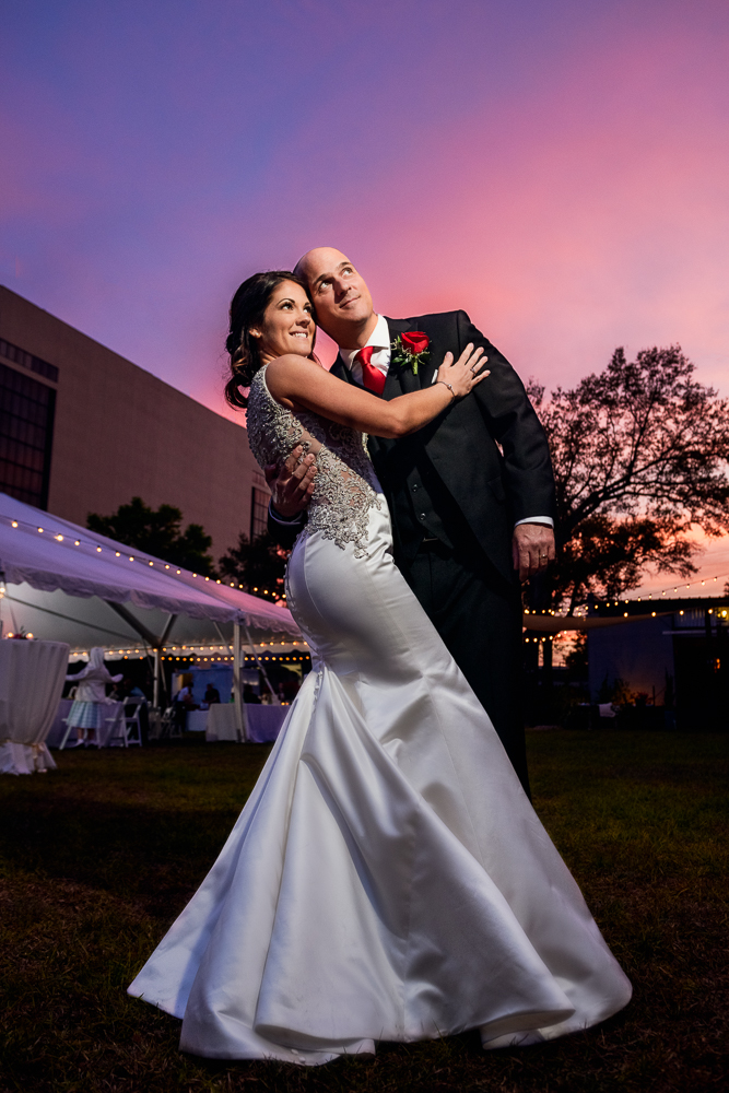 Bride and Groom looking into the distance at sunset at the Rails on Wright Street, Classic Red and White Wedding, Lazzat Photography, wedding photography, wedding photographer