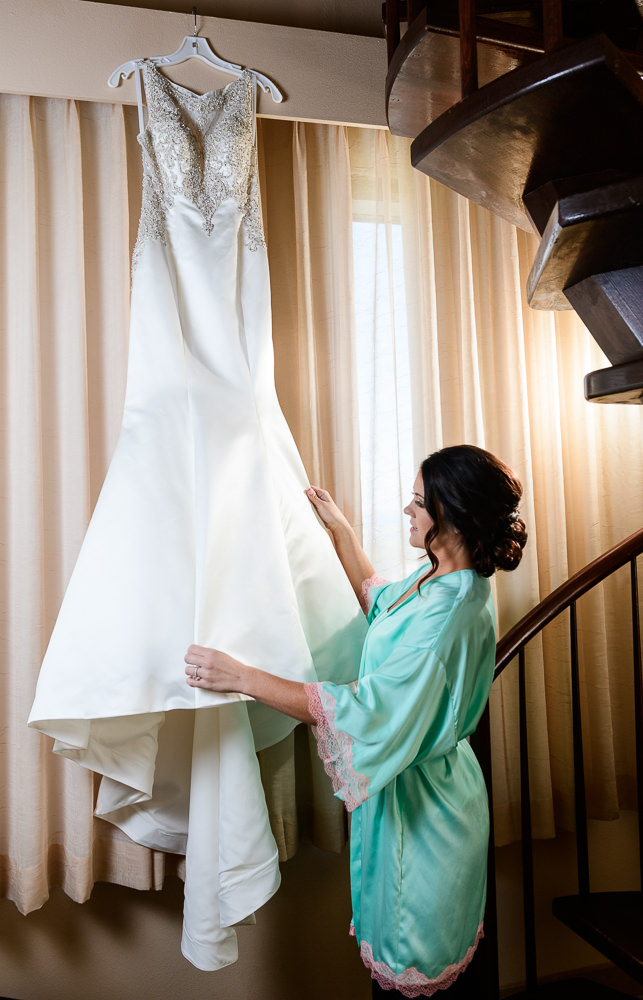 Bride looking at her wedding gown, Pensacola Florida, The Pensacola Grand Hotel, Classic Red and White Wedding, Lazzat Photography