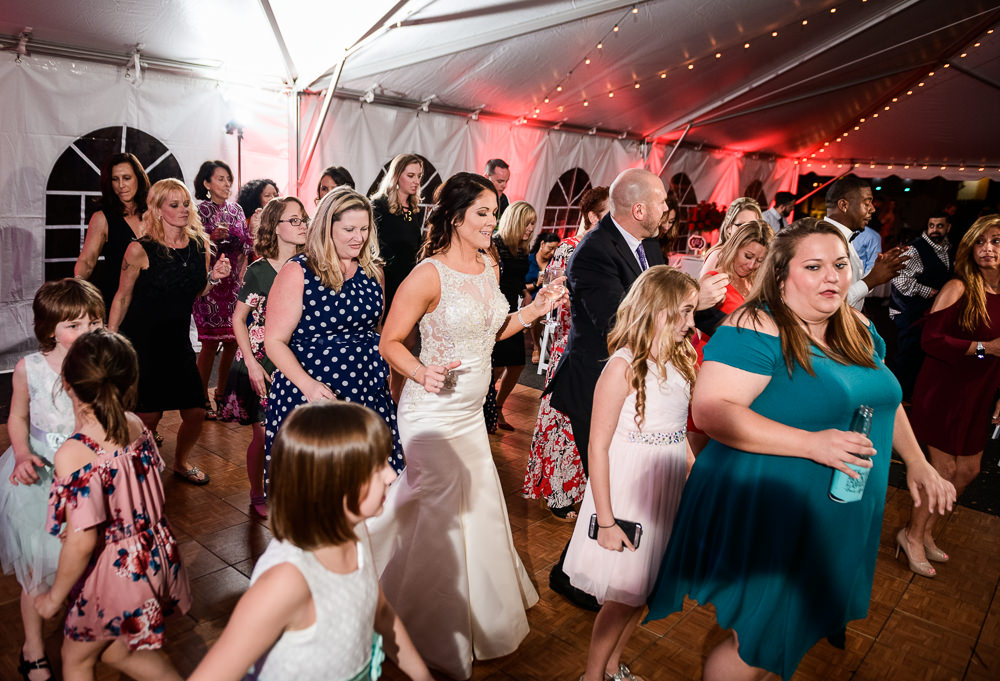 Bride dancing with guests at the reception at the Rails on Wright Street, Classic Red and White Wedding, Lazzat Photography, wedding photography, wedding photographer