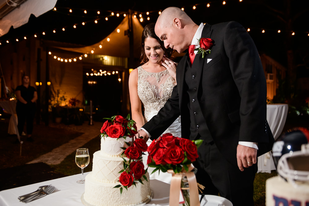 Bride and Groom cutting their wedding cake at the reception at the Rails on Wright Street, Classic Red and White Wedding, Lazzat Photography, wedding photography, wedding photographer