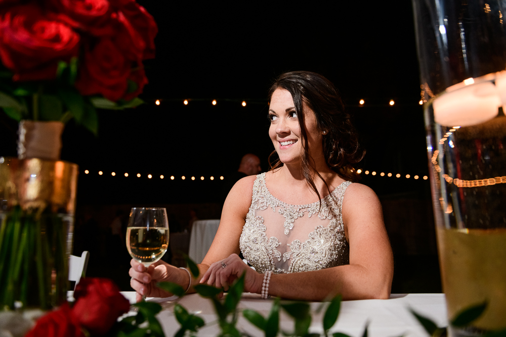 Bride smiling during the reception at the Rails on Wright Street, Classic Red and White Wedding, Lazzat Photography, wedding photography, wedding photographer